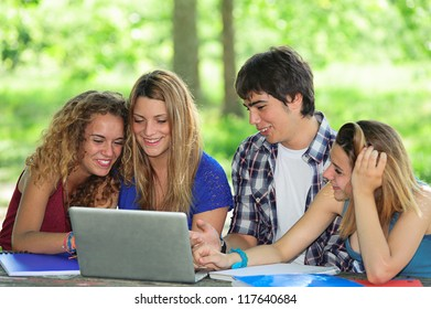 Group of young student using laptop outdoor