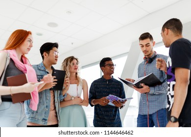 A group of young students from different countries communicate at the University. The photo illustrates education, College, school, or University.