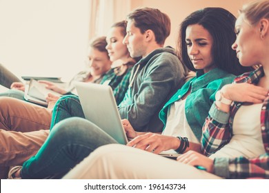 Group of young students preparing for exams in apartment interior