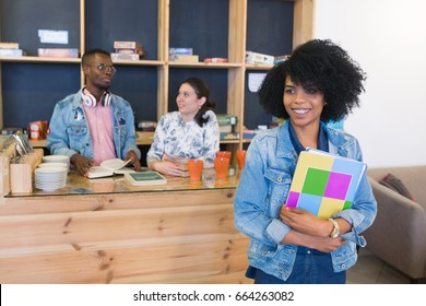 Group of young students preparing for exams in cafe