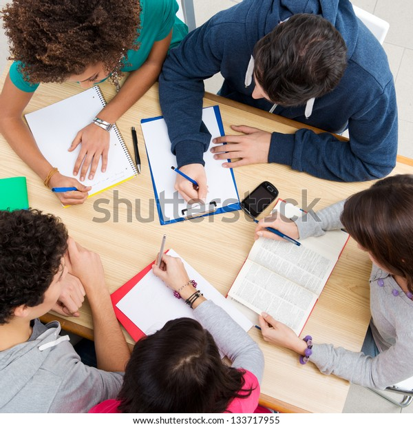 Group of young students studying together at college, high view angle
