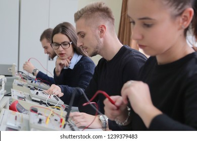 Group of young students in technical vocational training with teacher, the lesson in technical college. Education and technology concept.