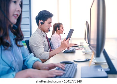 Group of young teamwork  businesspeople with headset and computer at office. Business assistance concept. - Shutterstock ID 1841775148