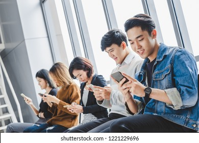 Group of young teen using smart phone for internet online with happy feeling