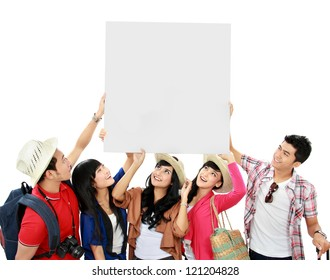 group of young tourist hold a white banner and look up