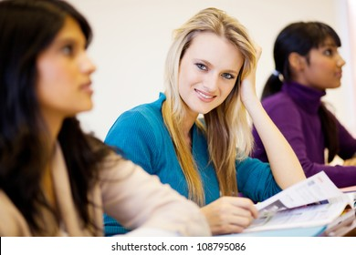 group of young university students in classroom