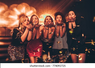 Group of young women blowing kisses