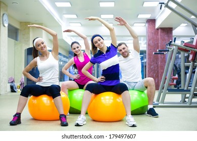 group of young women doing fitness exercise in  gym