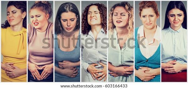 Skupina mladých žen s rukama na břiše, které mají špatné bolesti bolesti