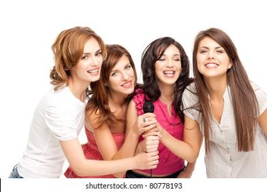 group of young women having fun at karaoke