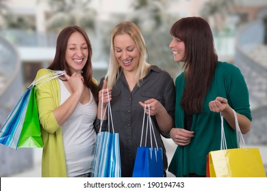 Group of young women shopping in a store or mall