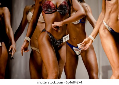 group of young women in swimsuit to competition in fitness bikini