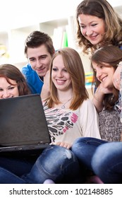 group of youth teens teenagers or college students with laptop computer