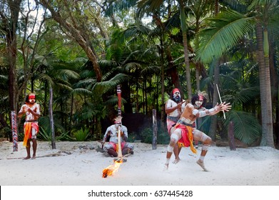Group of Yugambeh Aboriginal warriors dancing and play music on Australian Aboriginal culture show in Queensland, Australia.