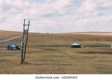 group of yurts in mongolia grassland with blue sky,horizontal