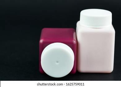 Groupe of cosmetic bottles at black background