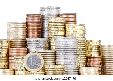 grouped stacks of EURO coins, isolated on white