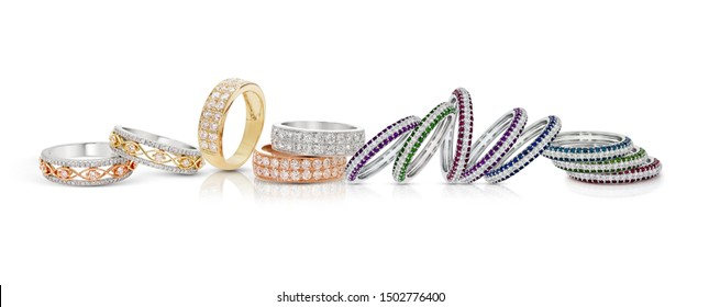 grouping of color gemstone rings with colored diamonds and gemstones on white background