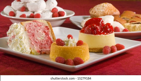 A grouping of desserts from strawberry cheesecake to powdered donuts.