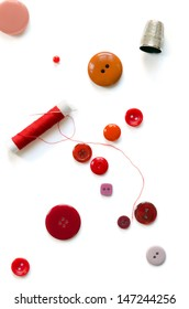 A grouping of items representing the occupation of sewing or crafting. On white background