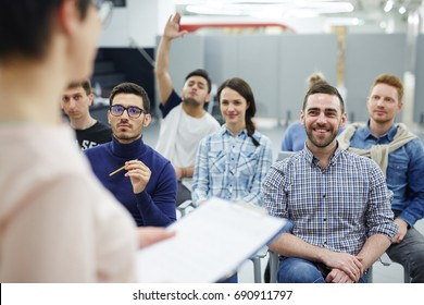 Groupmates listening to lecturer or speaker at conference