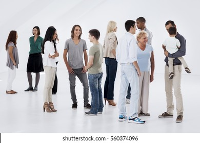 Groups of different people standing randomly and talking.