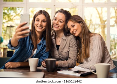 Groups of female firends making a selfie during a pause on the studies