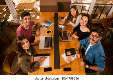 Groups of friends studying together on the bibliotech