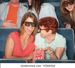 Groups of people in the audience with 3D glasses and laughing