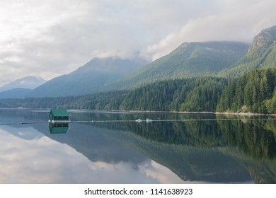 Grouse Mountain Reflection on Capilano reservoir lake located at North Vancouver, British Columbia Canada