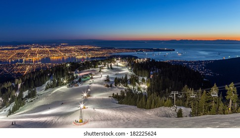 Grouse Mountain ski resort with a beautiful view of Vancouver city, British Columbia, at dusk