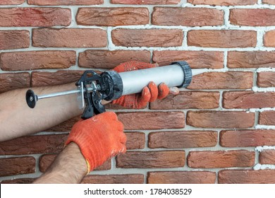Grouting decorative gypsum brick with white cement grout. Applying grout with a syringe.