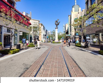 The Grove Los Angeles, California, USA. May 30, 2019. The statue of Spirit at the Grove. Destination for business, shopping, tourism. People, mall and blue sky background.