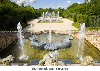 Grove of the Three Fountains spraying water in Versailles Chateau. France