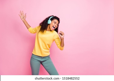 I'll grow up and become star person in music world in the future! Photo of talented gifted with strong loud voice teenager teen girl holding mic singing enjoying melody isolated pink background