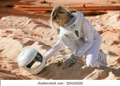 Grow plants on Mars, futuristic astronaut without a helmet,  another planet, image with the effect of toning