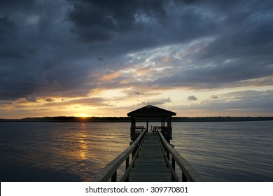 """""""Growing Dark On the Dock"""" Another dramatic Lowcountry sunset over the Colleton River tidal estuary near Hilton Head Island, SC."""