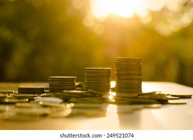 growing money coins stack  with sunset, Saving concept