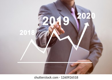 Growth in 2019 - 2020 year concept. Businessman chart and increase of positive indicators in his business.