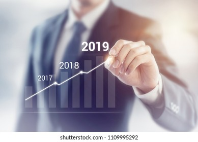 Growth in 2019 year concept. Businessman plan and increase of positive indicators in his business.