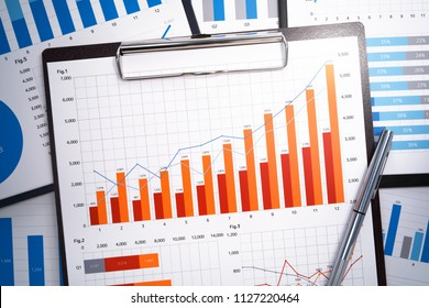 Growth charts and graphs. Pile of business reports. Gathering and analyzing statistical data.