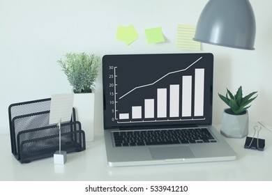 Growth graph business concept with laptop in office