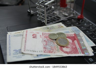 Growth in online shopping is observed worldwide. In the photo - Bulgarian money in a shopping cart.