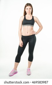 Growth portrait of fitness woman in sportswear on a white background. Healthy lifestyle. Mock up