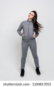 Growth portrait of a young beautiful sportswoman in a sports suit. Healthy lifestyle.