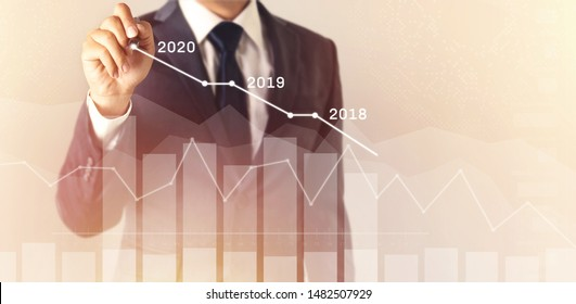 Growth success in 2020 concept. Businessman in suit plan profit chart with pen and increase of positive indicators in his business. graph business finance plan year 2018, 2019 to 2020.