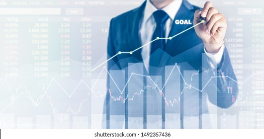 Growth success in goal concept. Businessman in blue suit plan with pen and increase of positive indicators in his business. graph business finance expectation plan year growth number digit stock table