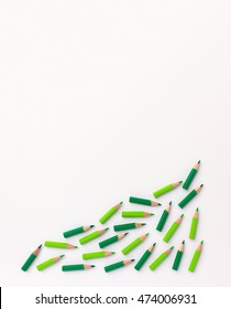 Growth and success visualized with green pencils  - template for business poster