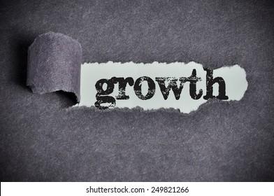 growth  word under torn black sugar paper
