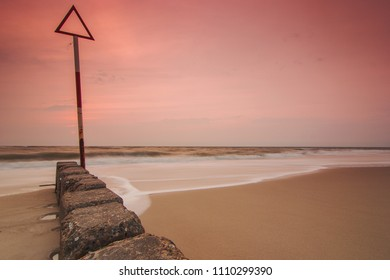 Groynes at the North Sea in the sunset. Westerland on Sylt